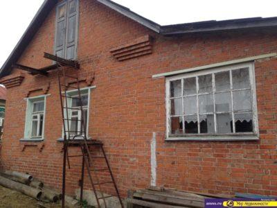 как поднять кирпичный дом